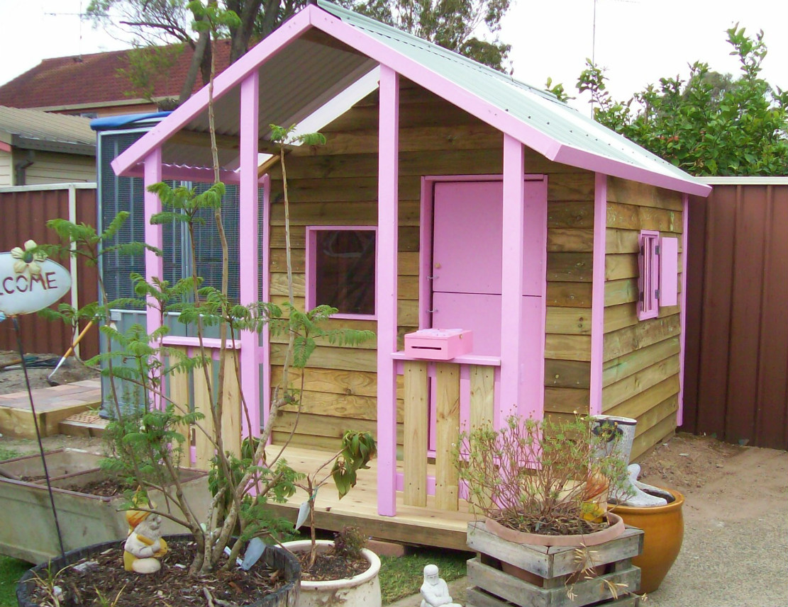 cubby house 2.8m x 1.8m with deck, x2 sliding perspex, x1 window shutter, barn door, painted trim $1450