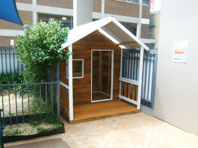 cubby house 2.2m x 1.8m with deck, x1 window opening, side rails only, stained $1330
