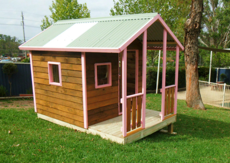 cubby house 2.8m x 1.8m with deck, x3 perspex windows, stained, slight elevation $1830