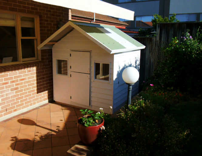 cubby house 1.8m x 1.8m painted, x2 perspex windows, barn door $1260