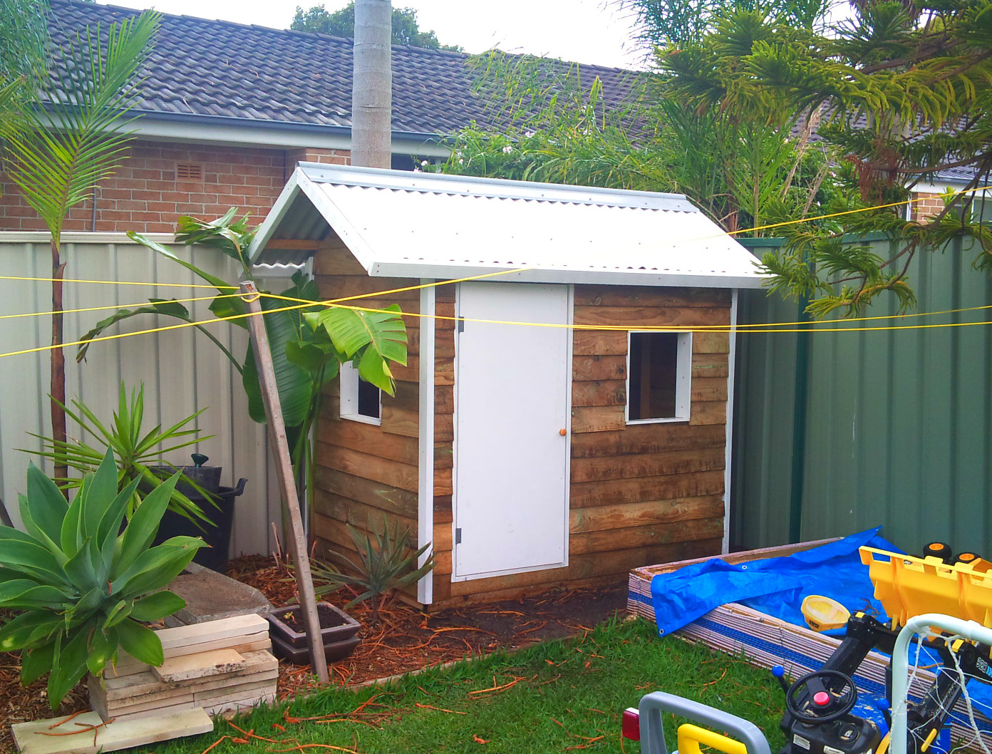 cubby house 1.8m x 1.2m, two perspex windows, plywood door, painted trim $910