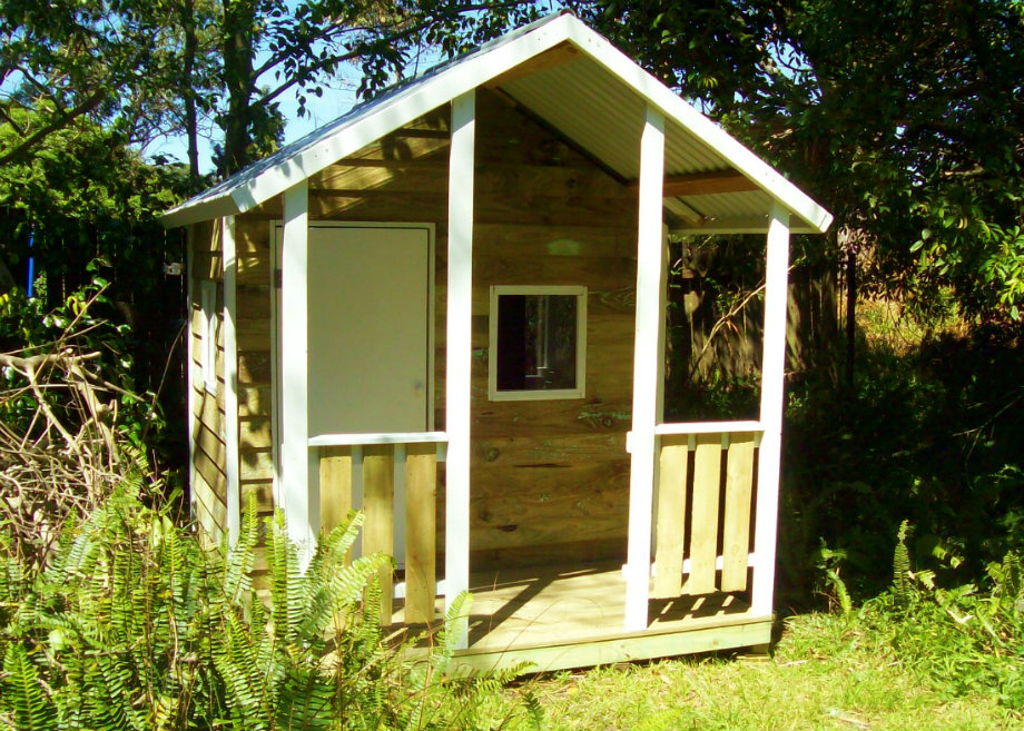 cubby house 2.2m x 1.8m with deck, plywood door, two perspex windows, painted trim $1250