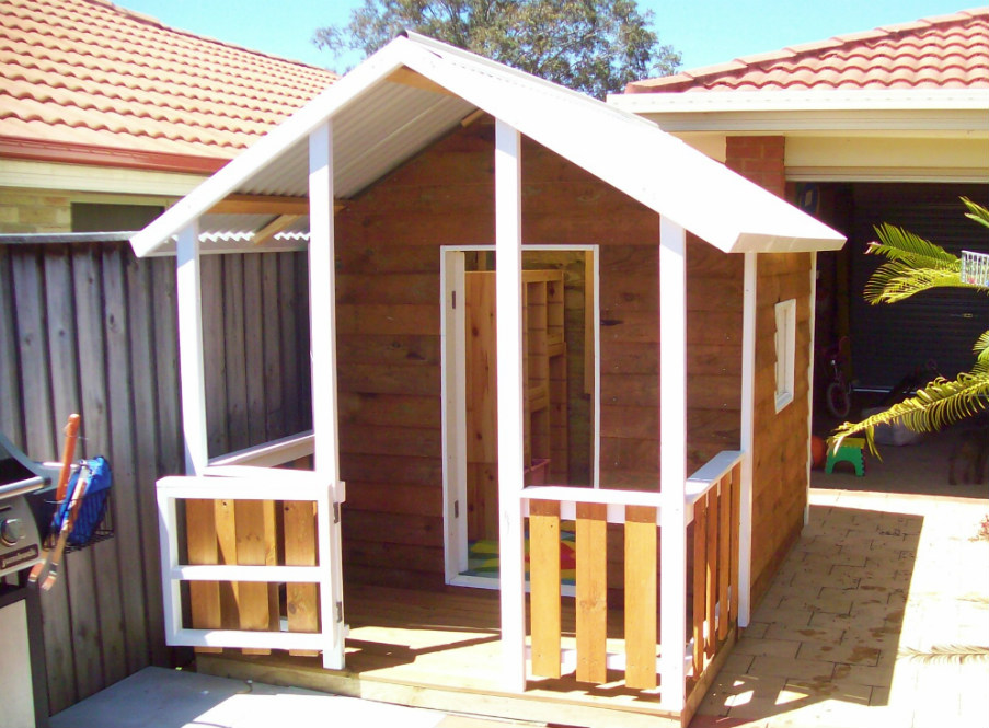 cubby house 2.8m x 1.8m with deck, side rails, front gate, two perspex windows, stained $1825