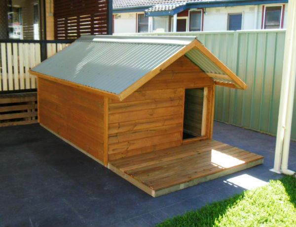 dog kennel 2.4m x 1.8m, gable roof, 1m x 1.8m timber deck, stained $1395