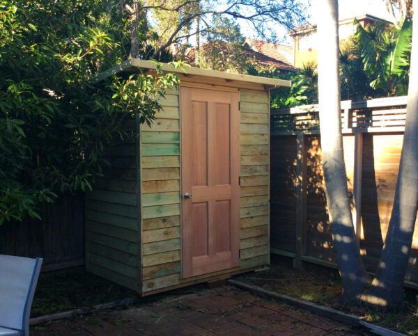 Small timber shed with hardwood door