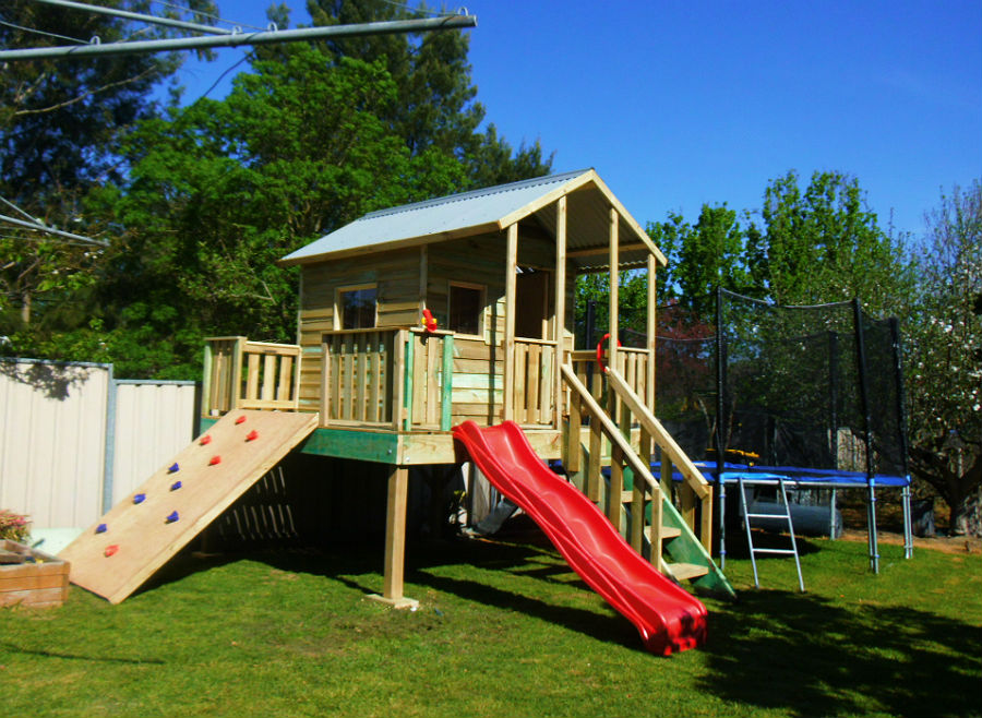cubby with covered verandah, slide and rock climbing wall