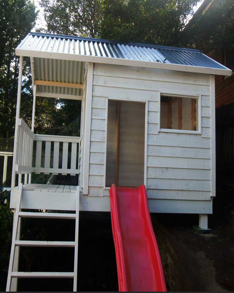 elevated cubby with step ladder and red slide suits DIY delivered in Melbourne, painted white