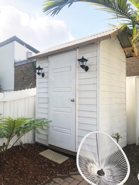 extra small garden tools shed with exterior lights