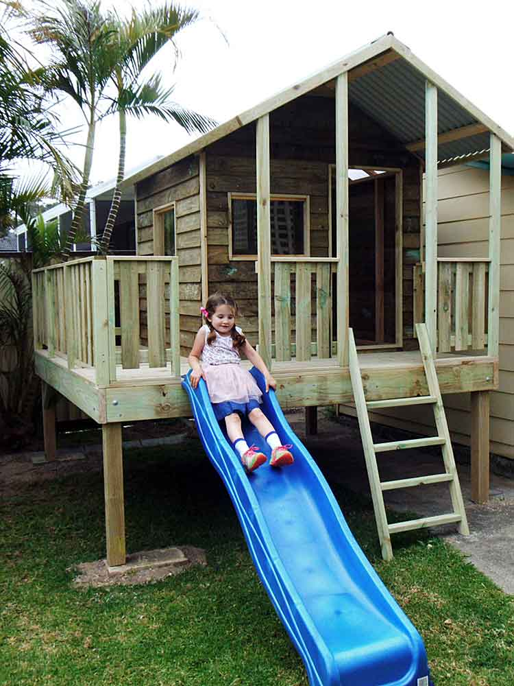 large hardwood timber cubby with blue slide, Ipswich