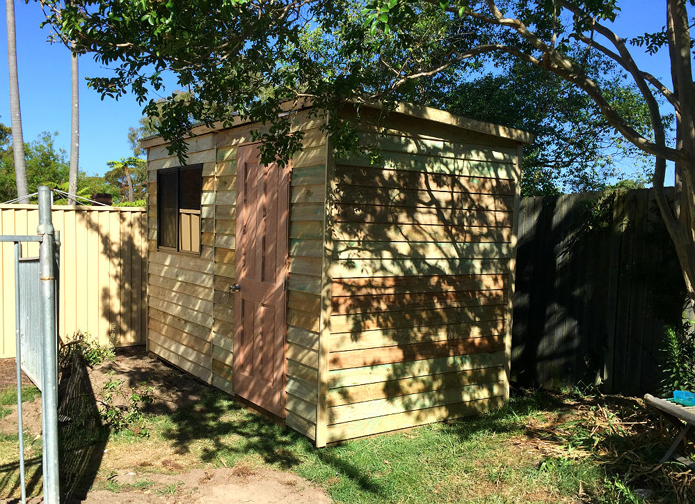 secure wooden garden shed with windows and slanted colorbond roof