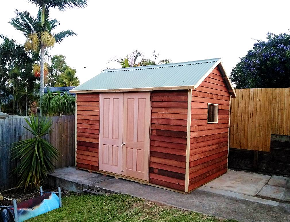 treated pine timber shed, featuring twin hinged barn doors for wide access