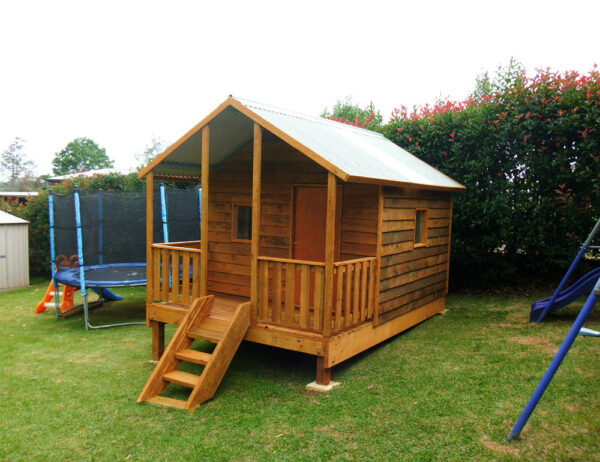 large cubby house with sheltered verandah 2.8m x 2.4m, stained, x2 perspex windows, ply door, side rails, 50cm elevation $2595 in kit form, ready to install