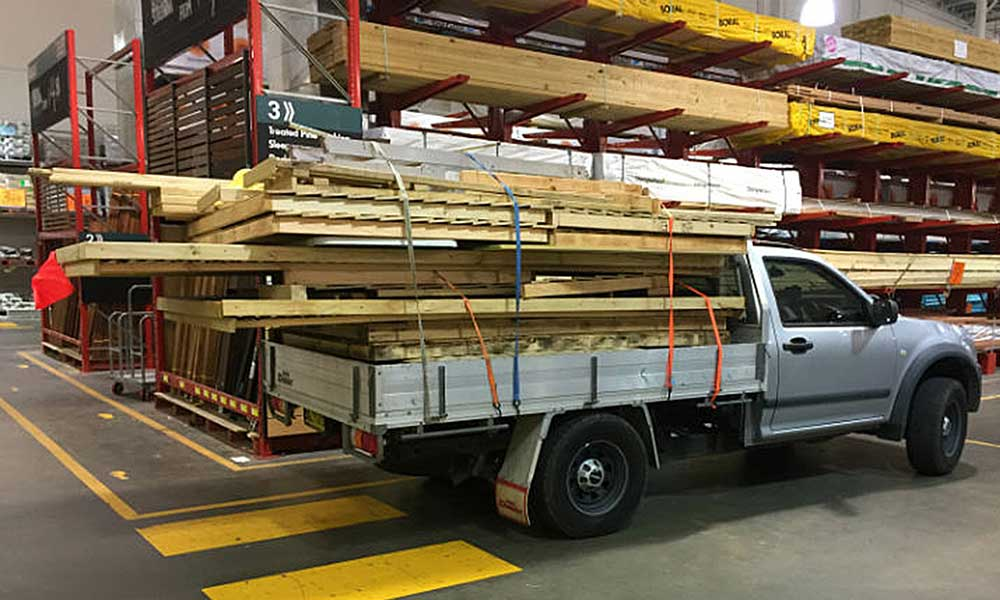 two flat pack timber sheds loaded for delivery by Aussie builder