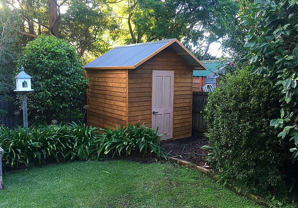 stylish, stained timber shed assembled from flat pack, with secure locking system